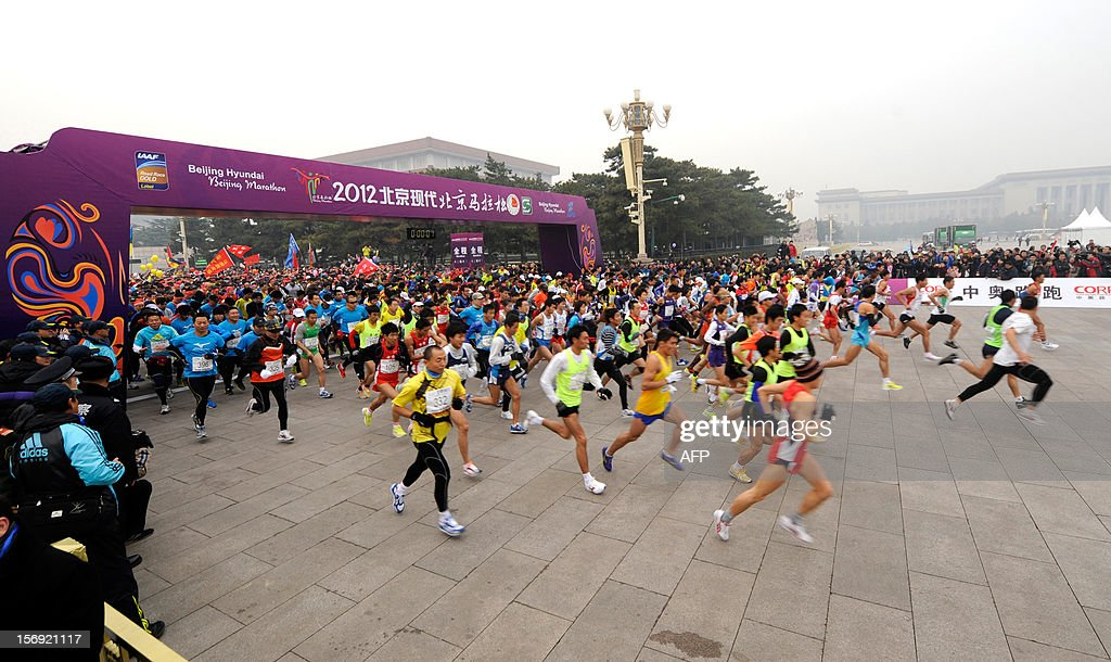 Competitors take off at the start of the Beijing Marathon in the Chinese capital on November 25, 2012. A total of 30,000 runners took part in the race. AFP PHOTO / WANG ZHAO