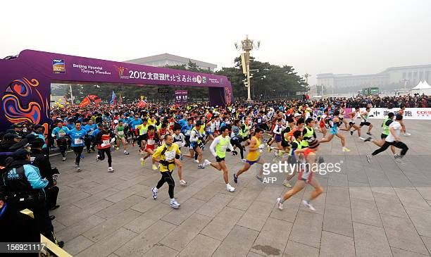 Competitors take off at the start of the Beijing Marathon in the Chinese capital on November 25 2012 A total of 30000 runners took part in the race...