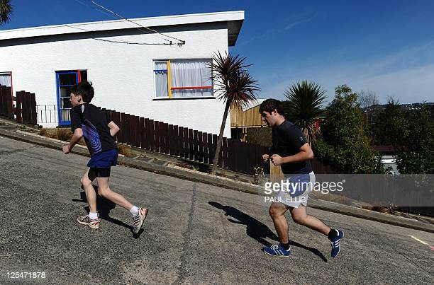 Competitors take part in a race up one of the world's steepest street in Dunedin New Zealand on September 18 2011 The race takes place up the Baldwin...