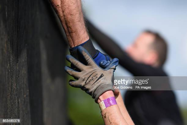 Competitors take part in Rat Race Dirty Weekend at Burghley House in Lincolnshire PRESS ASSOCIATION Photo Rat Race Dirty Weekend is the world's...