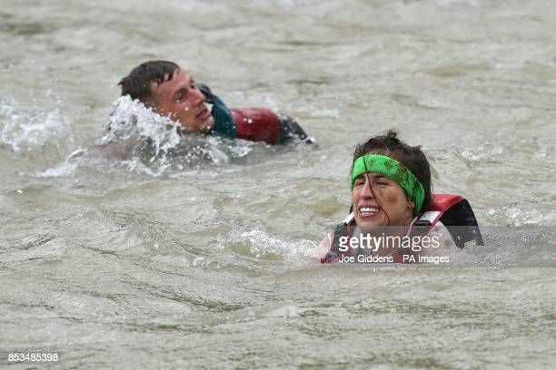 Competitors take part in Rat Race Dirty Weekend at Burghley House in Lincolnshire
