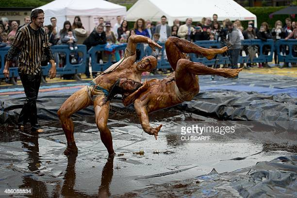 Competitors take part in the 8th annual World Gravy Wrestling Championships at the Rose n Bowl Pub in Bacup north west England on August 31 2015...