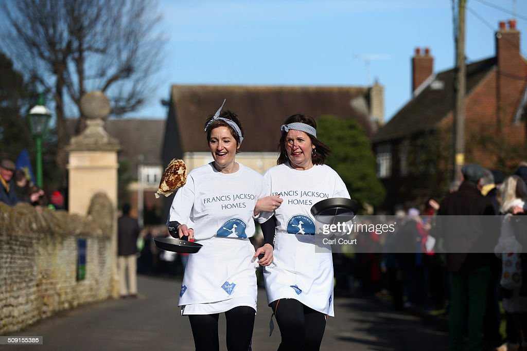 Competitors take part in the annual Shrove Tuesday trans-Atlantic pancake race on February 9, 2016 in Olney, England. On Shrove Tuesday every year the ladies of Olney, Buckinghamshire compete in a Pancake Race, a tradition which dates back to 1445. Children from Olney schools also take part in their own races. Olney competes every year against the women of Liberal, Kansas, USA in a friendly race dating back to 1950.