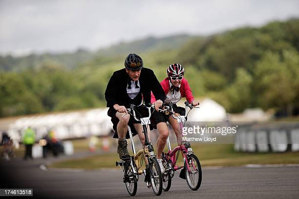 Competitors take part in the Brompton World Championship folding bike race which is part of the Orbital cycling festival at Goodwood Motor Circuit on...