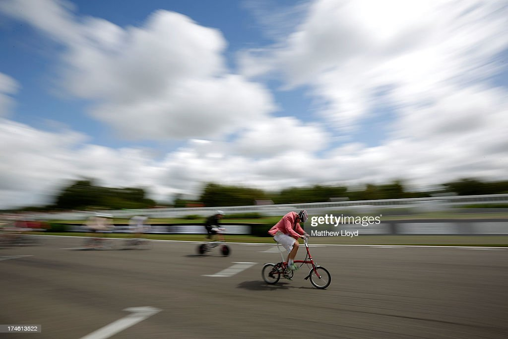 Competitors take part in the Brompton World Championship folding bike race, which is part of the Orbital cycling festival at Goodwood Motor Circuit on July 28, 2013 in Chichester, England. The race starts with a Le-Mans style sprint to the rider's bike, which is then assembled and followed by a 15.2km ride. A strict dress code of jacket and tie applies, with an award going to the most stylishly dressed.