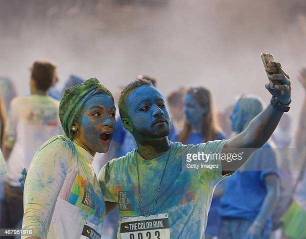 Competitors take part in The Color Run on March 27 2015 in Abu Dhabi United Arab Emirates