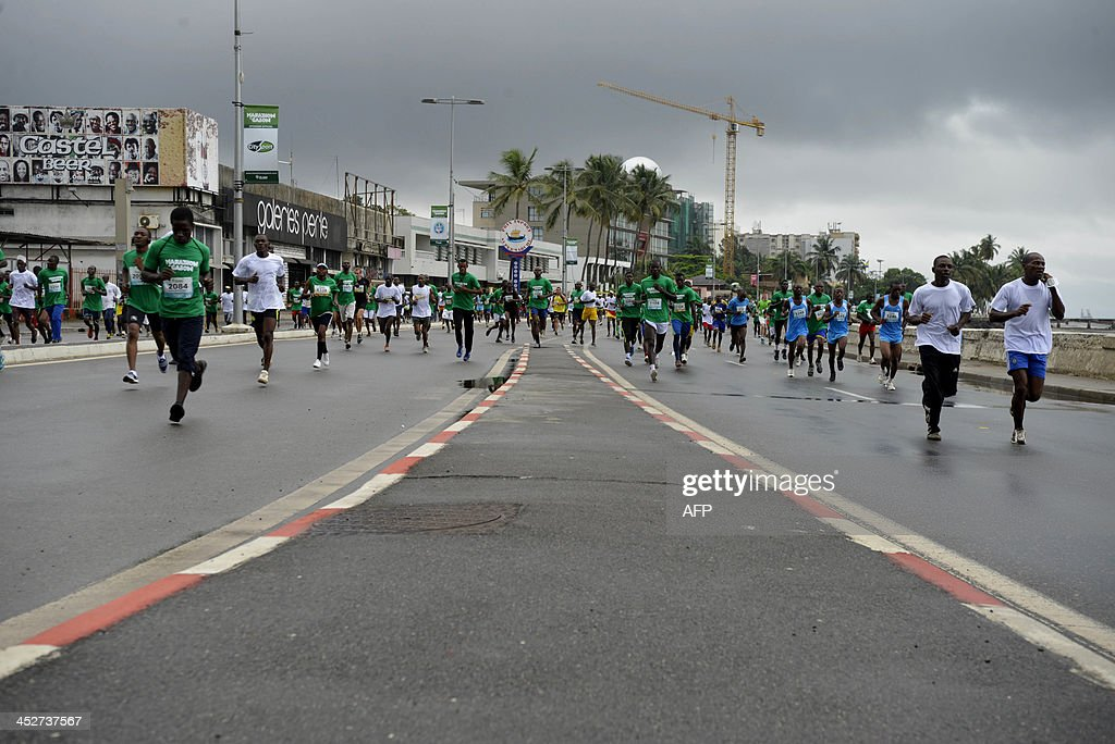 Competitors take part in the first Marathon of Gabon on December 1 2013 in Libreville AFP PHOTO XAVIER BOURGEOIS