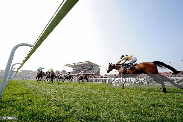 Competitors take part in the first race The Top Novices Hurdle on the second day of the Grand National meeting at Aintree Racecourse in Liverpool...