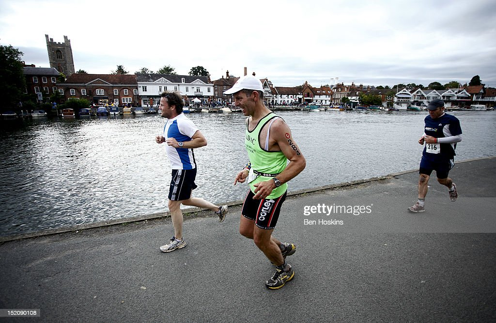 Competitors take part in the running leg at the Challenge Henley-on-Thames Triathlon on September 16, 2012 in London, England.