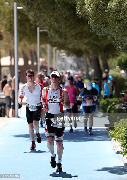 Competitors take part in the running leg during Ironman 703 on May 9 2015 in Palma de Mallorca Spain