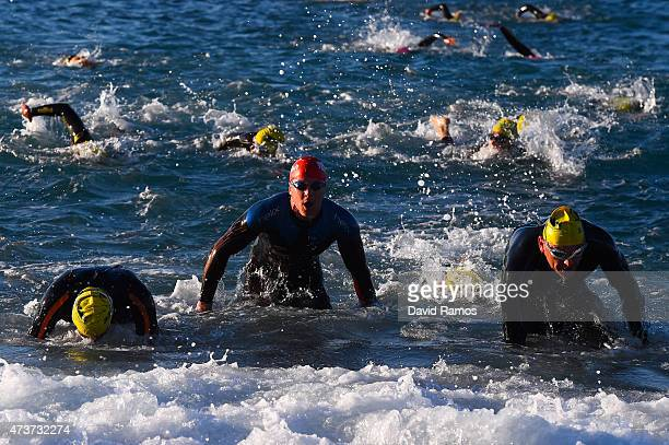 Competitors take part in the swimming leg during Ironman 703 on May 17 2015 in Barcelona Spain