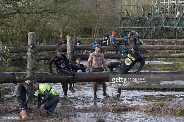 Competitors take part in the 'Tough Guy' adventure race near Wolverhampton Staffordshire West Midlands on February 1 2015 The event challenges...