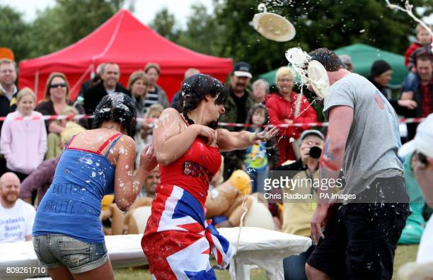 Competitors take part in the World Custard Pie Championships at Coxheath Village Hall in Kent
