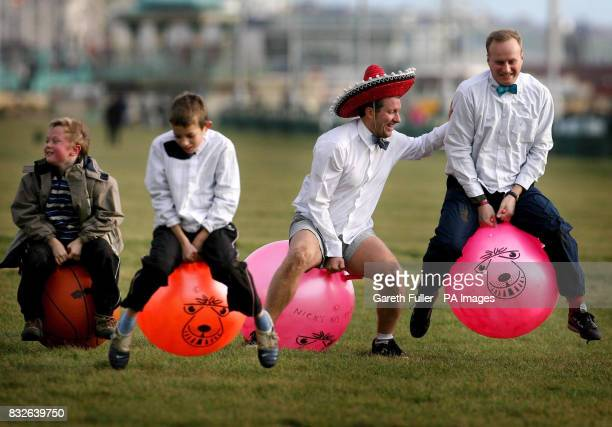 Competitors take part in the worlds largest spacehopper race in aid of testicular cancer on Brighton sea front in Sussex