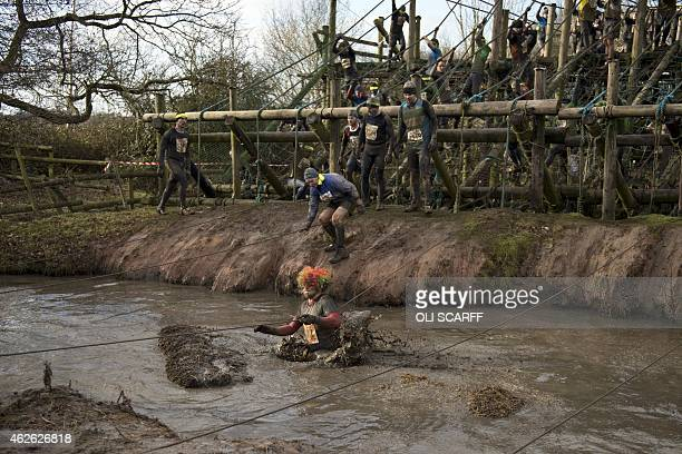 Competitors take part in 'Tough Guy' adventure race near Wolverhampton Staffordshire West Midlands on February 1 2015 The event challenges thousands...