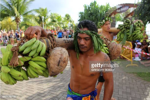 Competitors take part on July 14 2014 in a fruit carrier race during the annual Heiva Tuaro Maohi sporting event bringing together since 2006 more...