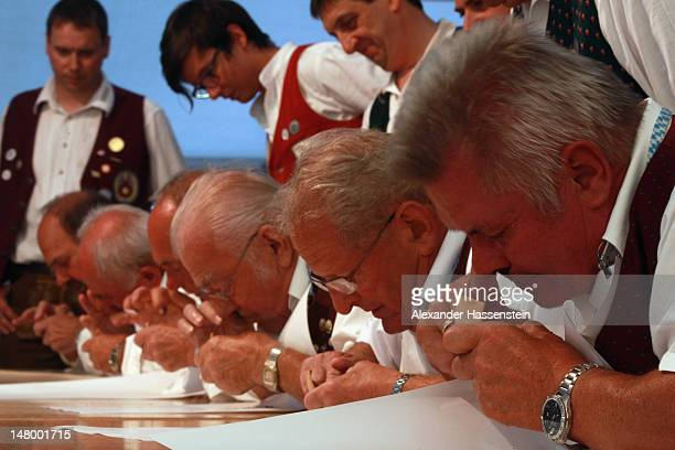 Competitors take snuff during 18th Snuff World Championships on July 7 2012 in Peutenhausen near Munich Germany 290 participants from Germany Austria...