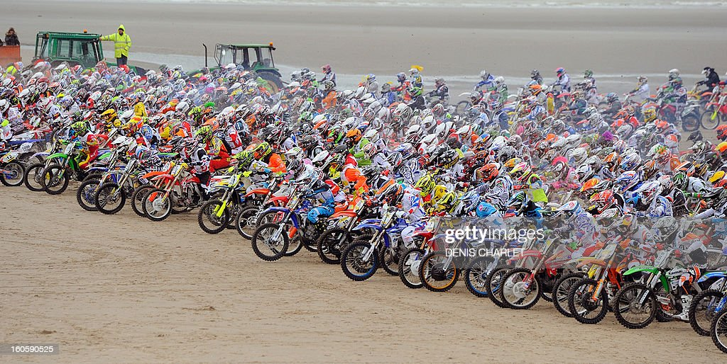 Competitors take the start during the 8th edition of the Touquet Enduropal motorcycling race on February 3, 2013 on the beach in Le Touquet, northern France. The Touquet Enduropal motorcycling replaces the traditional Enduro, created by Thierry Sabine motorcycle racer - founder and main organizer of Paris Dakar, in the 80s. Some 1,000 competitors attend the 11,800 km race. AFP PHOTO DENIS CHARLET