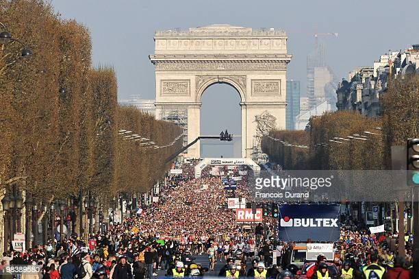 Competitors take the start of the 34th Paris Marathon on April 11 2010 in Paris France