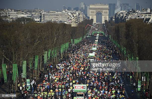 Competitors take the start of the 40th Paris Marathon near the Arc de Triomphe monument on April 3 in Paris Some 57000 participants from 160...