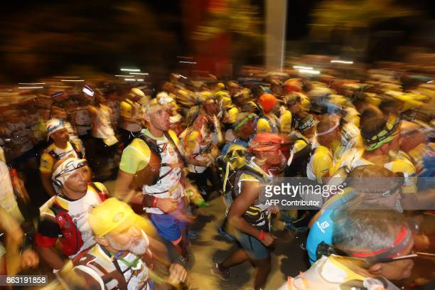 Competitors take the start of the Grand Raid ultramarathon on the French Indian ocean island of Reunion on October 19 2017 in SaintPierre The Grand...