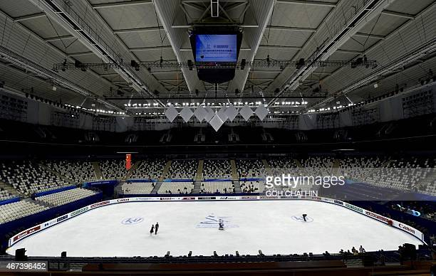 Competitors take to the ice rink during a practice session for the 2015 ISU World Figure Skating Championships at the Shanghai Oriental Sports Center...
