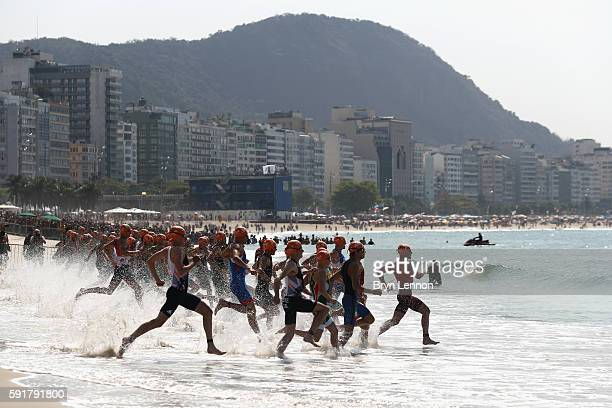 Competitors take to the water during the Men's Triathlon at Fort Copacabana on Day 13 of the 2016 Rio Olympic Games on August 18 2016 in Rio de...
