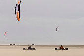 Competitors taking part in one of the races at the European Kite Buggy Championships at Hoylake Wirral north west England Around 75 buggies with both...