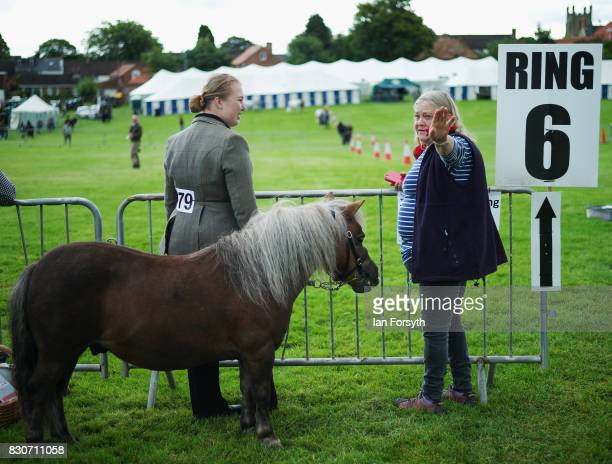 Competitors wait at the side of the show arena during the 194th Sedgefield Show on August 12 2017 in Sedgefield England The annual show is held on...
