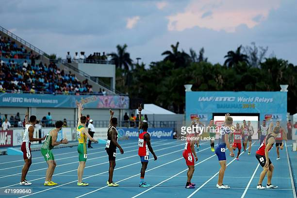 Competitors wait for their teammates during round one of the men's 4 x 400 metres relay on day one of the IAAF World Relays at Thomas Robinson...