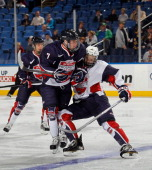 T Compfer of Team Housley steps into Hudson Fasching of Team McClanahan at the USA Hockey AllAmerican Prospects Game at the First Niagara Center on...