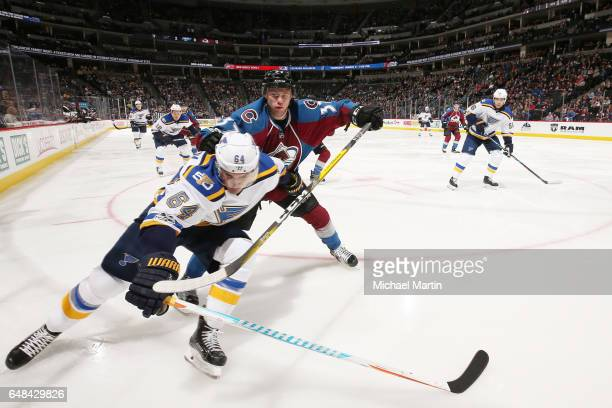 T Compher of the Colorado Avalanche skates against Nail Yakupov of the St Louis Blues at the Pepsi Center on March 5 2017 in Denver Colorado