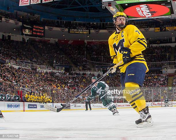 Compher of the Michigan Wolverines follows the play against the Michigan State Spartans during the 'Dual in the D' inaugural game for the new Iron D...