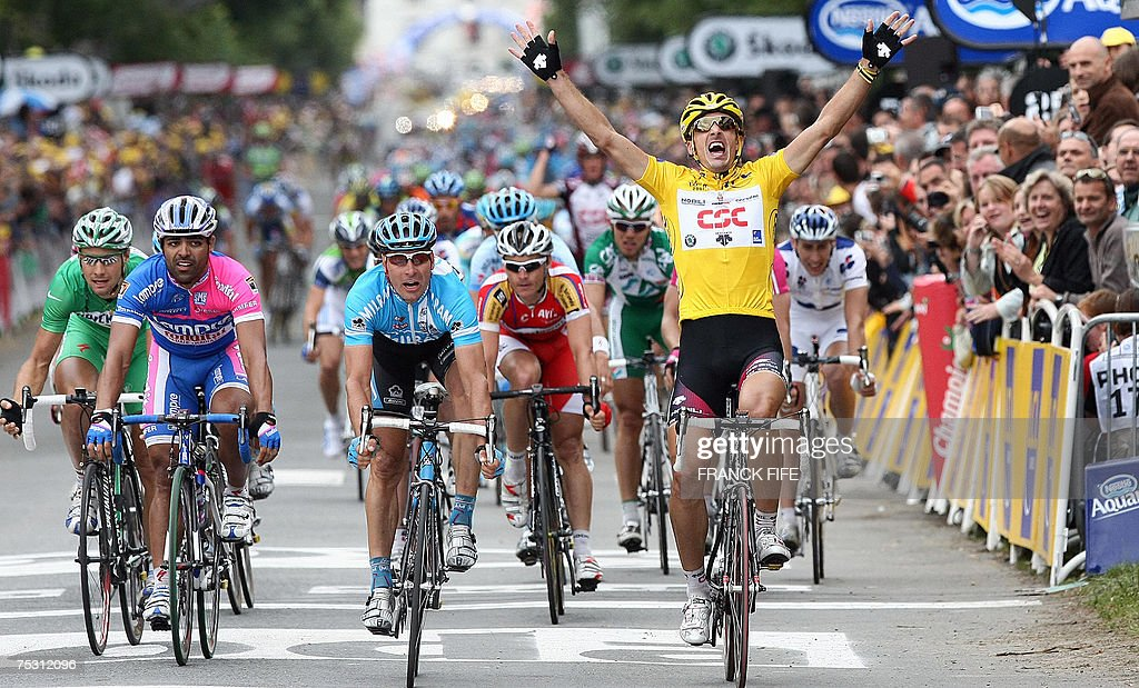 Switzerlands Fabian Cancellara celebrates as he crosses the finish line of the third stage of the 94th Tour de France cycling race between Waregem...