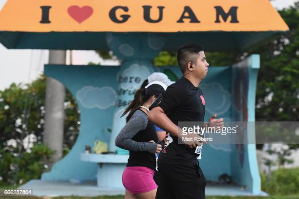 Compitors run during the United Airlines Guam Marathon 2017 on April 9 2017 in Guam Guam
