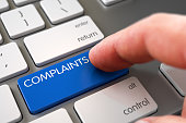 Hand Pushing Blue Complaints Modern Laptop Keyboard Key. 3D Illustration.