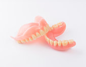 Complete denture on white background.