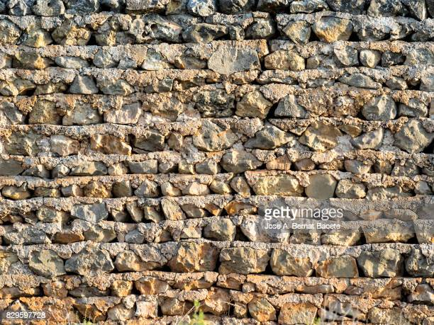 Complete setting of the textures produced by the erosion in a wall of sedimentary rock