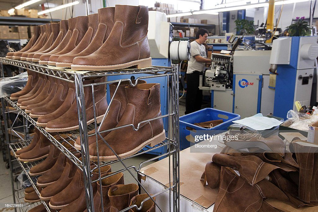 Completed and uncompleted boots sit on shelving at the Roots Ltd. manufacturing facility in Toronto, Ontario, Canada, on Wednesday, March 20, 2013. Roots Ltd., a Canadian clothing and lifestyle products retailer, manufactures footwear, leather goods, active athletic wear, yoga wear, accessories and home furnishings. Photographer: Norm Betts/Bloomberg via Getty Images