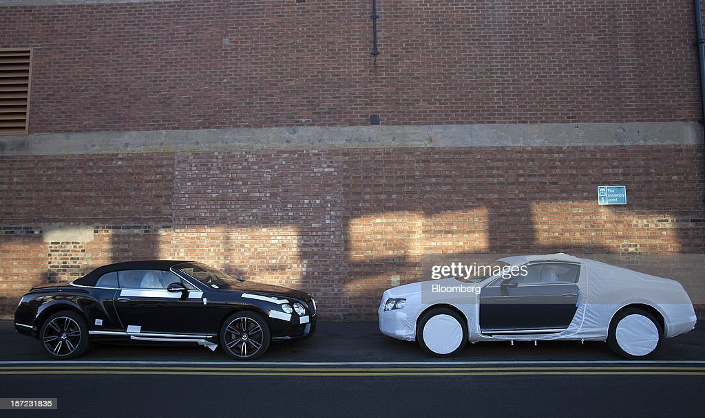 Completed Bentley Continental automobiles sit masked with protective material outside the workshop at Bentley Motors Ltd.'s plant in Crewe, U.K., on Thursday, Nov. 29, 2012. Consumer spending and exports propelled the U.K. economy to its fastest growth since 2007 in the third quarter as the Olympics and a post-Jubilee rebound saw household expenditure rise the most in more than two years. Photographer: Simon Dawson/Bloomberg via Getty Images