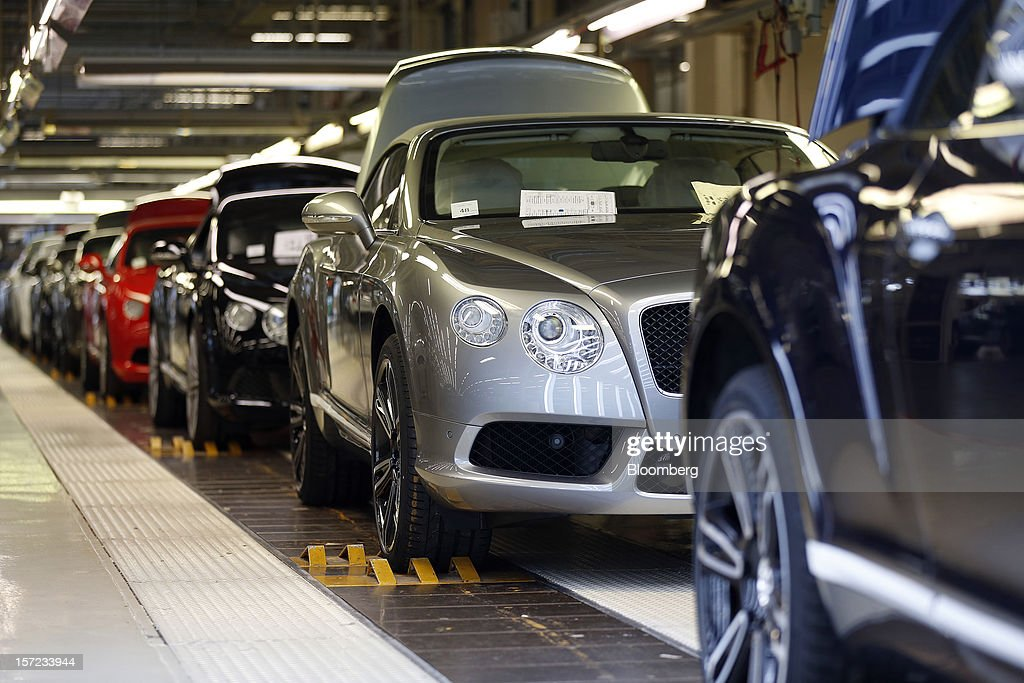 Completed Bentley Continental automobiles sit on the production line at the Bentley Motors Ltd. workshop in Crewe, U.K., on Thursday, Nov. 29, 2012. Consumer spending and exports propelled the U.K. economy to its fastest growth since 2007 in the third quarter as the Olympics and a post-Jubilee rebound saw household expenditure rise the most in more than two years. Photographer: Simon Dawson/Bloomberg via Getty Images