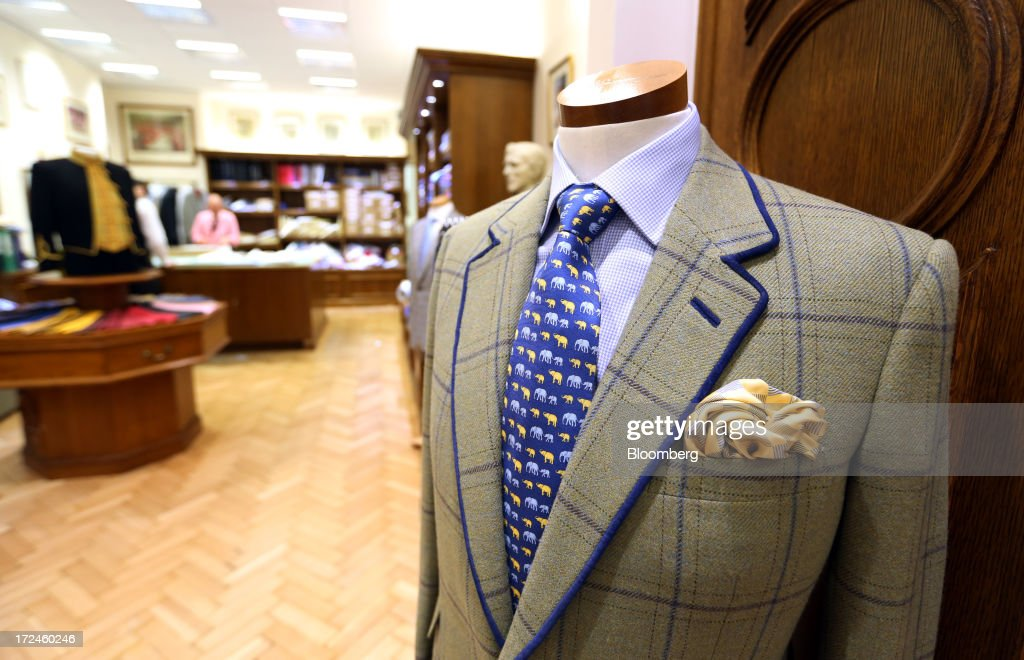 A completed gentlemen's jacket sits on display at the tailors Dege & Skinner based on Savile Row in London, U.K., on Tuesday, July 2, 2013. New orders at manufacturers rose for a fourth month in June, led by the textiles clothing industry, while input costs fell for a third month. Photographer: Chris Ratcliffe/Bloomberg via Getty Images