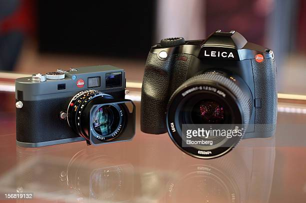 A completed Leica M left and S2 series digital cameras sit on display at the Leica Camera AG headquarters in Solms Germany on Wednesday Oct 31 2012...