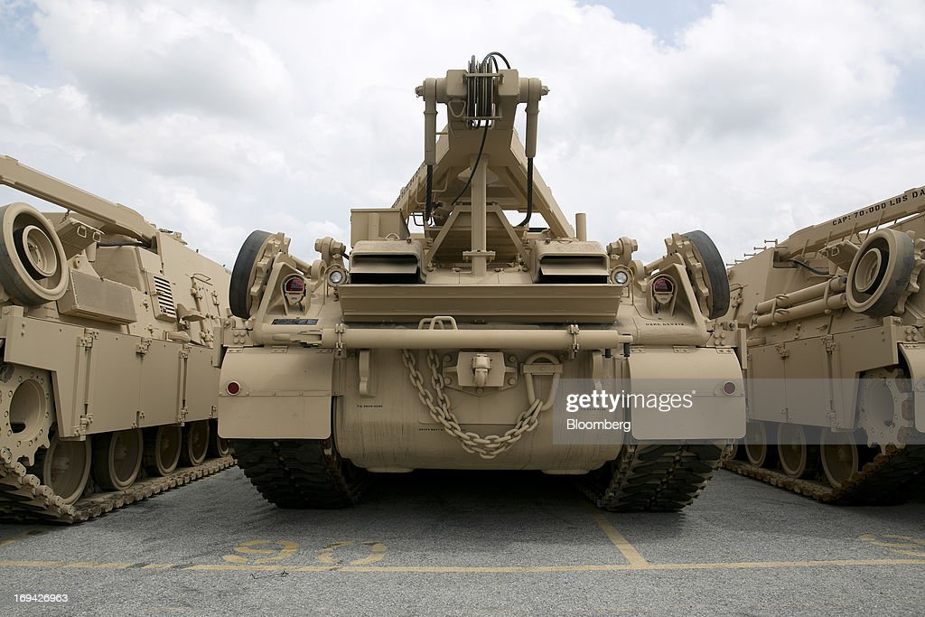 Completed M88 Hercules heavy recovery vehicles wait for delivery at the BAE Systems Plc Land & Armaments facility in York, Pennsylvania, U.S., on Thursday, May 23, 2013. BAE Systems Plc is deploying smaller suppliers to pressure U.S. lawmakers to speed up orders to modernize Bradley fighting vehicles, a move the company said may protect thousands of subcontractor jobs and keep a Pennsylvania assembly line open. Photographer: Andrew Harrer/Bloomberg via Getty Images