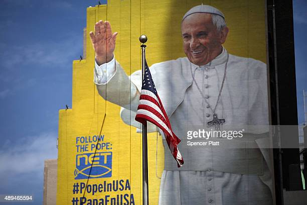 A completed mural of Pope Francis is viewed on the side of a building in midtown Manhattan on September 21 2015 in New York City The Pope will be...