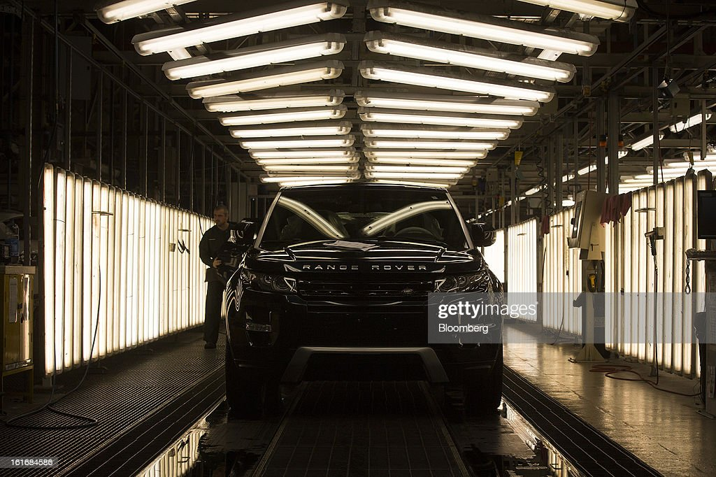 A completed Range Rover Evoque SUV automobile, produced by Jaguar Land Rover Plc, a unit of Tata Motors Ltd., stands parked ahead of inspection at the company's assembly plant in Halewood, U.K., on Wednesday, Feb. 13, 2013. Carmakers from Ford Motor Co. to Audi AG and Jaguar Land Rover Plc are using record amounts of aluminium to replace heavier steel, providing relief to producers of the metal confronting excess supplies and depressed prices. Photographer: Simon Dawson/Bloomberg via Getty Images
