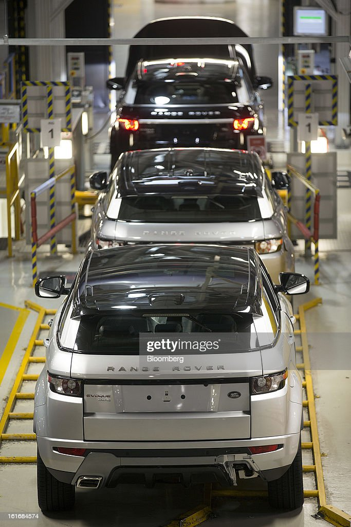 Completed Range Rover Evoque SUV automobiles, produced by Jaguar Land Rover Plc, a unit of Tata Motors Ltd., travel along the production line at the company's assembly plant in Halewood, U.K., on Wednesday, Feb. 13, 2013. Carmakers from Ford Motor Co. to Audi AG and Jaguar Land Rover Plc are using record amounts of aluminium to replace heavier steel, providing relief to producers of the metal confronting excess supplies and depressed prices. Photographer: Simon Dawson/Bloomberg via Getty Images