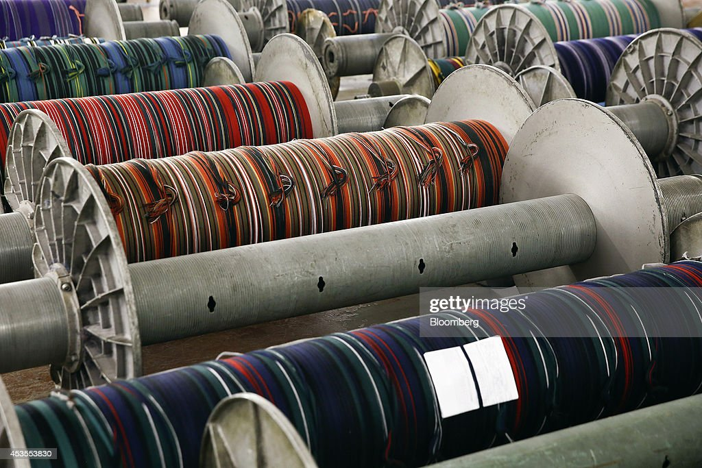 Completed tartan materials sit on spools ahead of use at Lochcarron John Buchan Ltd.'s production plant in Selkirk, U.K., on Tuesday, Aug. 12, 2014. Scottish nationalists seeking independence from the U.K. lost ground in the latest poll of voting intentions for the Sept. 18 referendum, as campaigners to keep the 307-year-old U.K. intact extended their lead. Photographer: Simon Dawson/Bloomberg via Getty Images