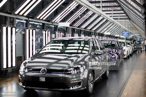 Completed Volkswagen eGolf electric automobiles stand in the light tunnel inside the Volkswagen AG factory in Dresden Germany on Monday April 3 2017...