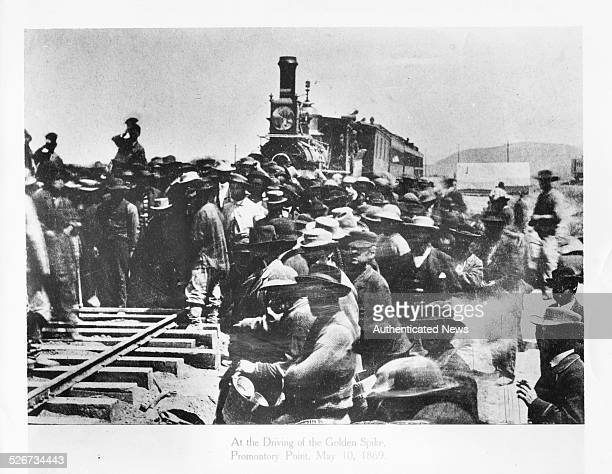 Completion of the first US transcontinental railroad with a Golden Spike ceremony taking place as trains of the Central Pacific and Union Pacific...